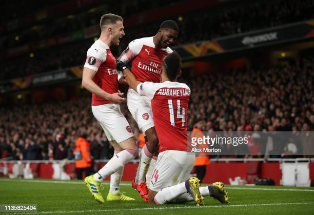 Ainsley MaitlandNiles of Arsenal celebrates with teammates PierreEmerick Aubameyang and Aaron Ramsey after scoring his team's second goal during the...