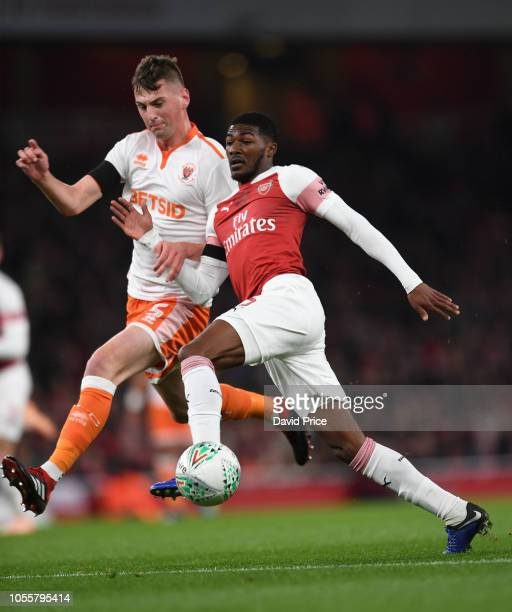 Ainsley MaitlandNiles of Arsenal controls the ball under pressure from Paudie O'Connor of Blackpool during the Carabao Cup Fourth Round match between...