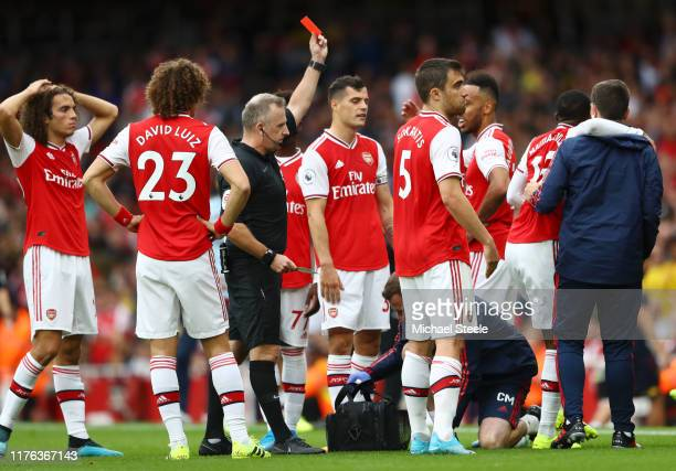 Ainsley Maitland-Niles of Arsenal fouls Neil Taylor of Aston Villa leading to a red card and his dismissal during the Premier League match between...