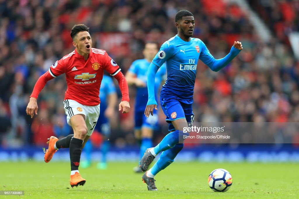 Ainsley Maitland-Niles of Arsenal gets away from Alexis Sanchez of Man Utd during the Premier League match between Manchester United and Arsenal at Old Trafford on April 29, 2018 in Manchester, England.