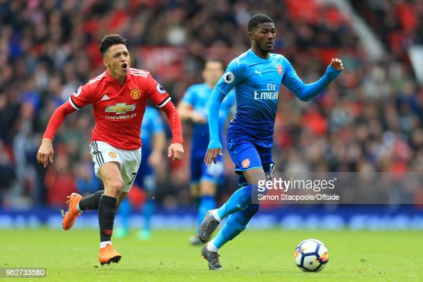 Ainsley MaitlandNiles of Arsenal gets away from Alexis Sanchez of Man Utd during the Premier League match between Manchester United and Arsenal at...