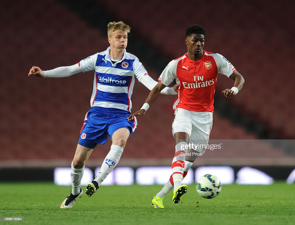 Ainsley Maitland-Niles of Arsenal gets to the ball ahead of Samuel Fridjonsson of Reading during the match between Arsenal U21 and Reading U21 in the Barclays Premier U21 League at Emirates Stadium on April 13, 2015 in London, England.