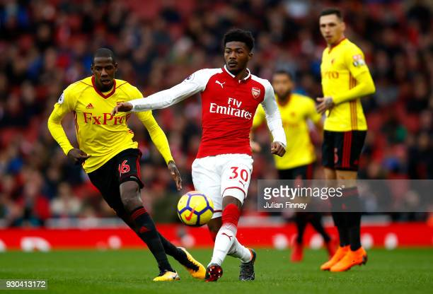 Ainsley MaitlandNiles of Arsenal holds of Abdoulaye Doucoure of Watford during the Premier League match between Arsenal and Watford at Emirates...
