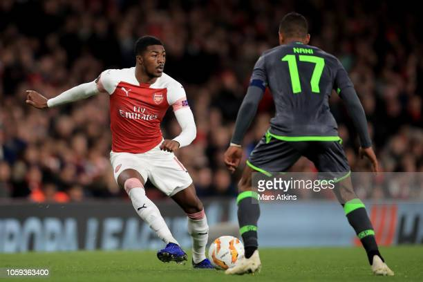 Ainsley MaitlandNiles of Arsenal in action with Nani of Sporting Lisbon during the UEFA Europa League Group E match between Arsenal and Sporting CP...