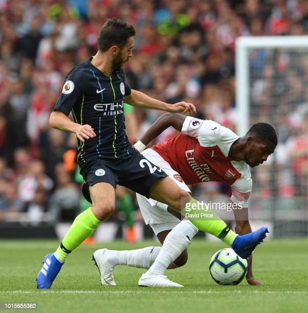 Ainsley MaitlandNiles of Arsenal is challenged by Bernardo Silva of Man City during the match the Premier League match between Arsenal FC and...
