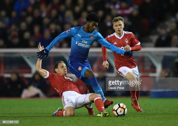 Ainsley MaitlandNiles of Arsenal is challenged by David Vaughan of Forest during the Emirates FA Cup 3rd Round match between Nottingham Forest and...