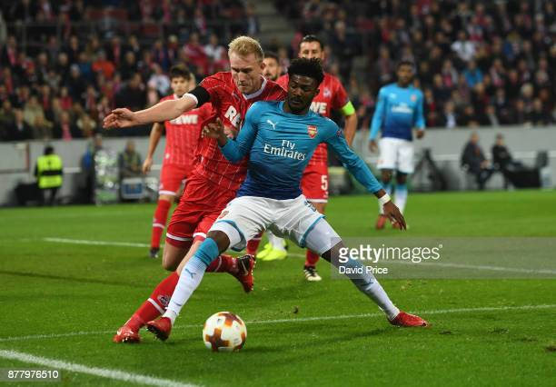 Ainsley MaitlandNiles of Arsenal is challenged by Frederik Sorensen of Cologne during the UEFA Europa League group H match between 1 FC Koeln and...