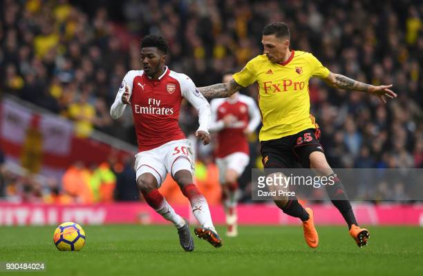 Ainsley MaitlandNiles of Arsenal is challenged by Jose Holebas of Watford during the Premier League match between Arsenal and Watford at Emirates...
