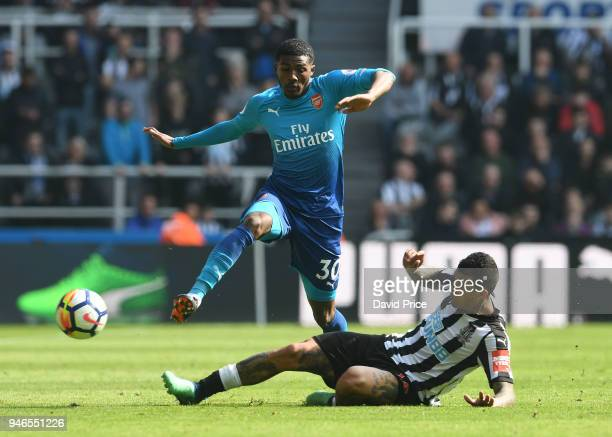 Ainsley MaitlandNiles of Arsenal is challenged by Kenedy of Newcastle during the Premier League match between Newcastle United and Arsenal at St...