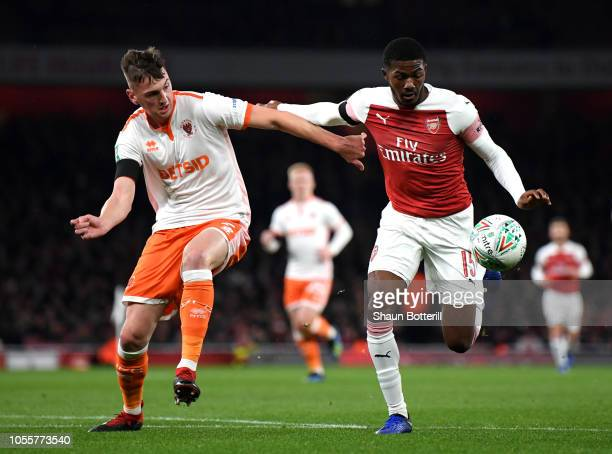 Ainsley MaitlandNiles of Arsenal is challenged by Paudie O'Connor of Blackpool during the Carabao Cup Fourth Round match between Arsenal and...