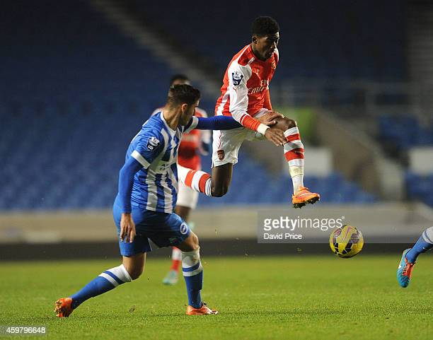 Ainsley Maitland-Niles of Arsenal is closed down by Tom Dallison of Brighton during the match between Brighton and Hove Albion and Arsenal in the...