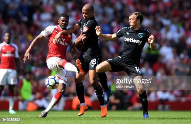 Ainsley MaitlandNiles of Arsenal Joao Mario and Mark Noble of West Ham United in action during the Premier League match between Arsenal and West Ham...