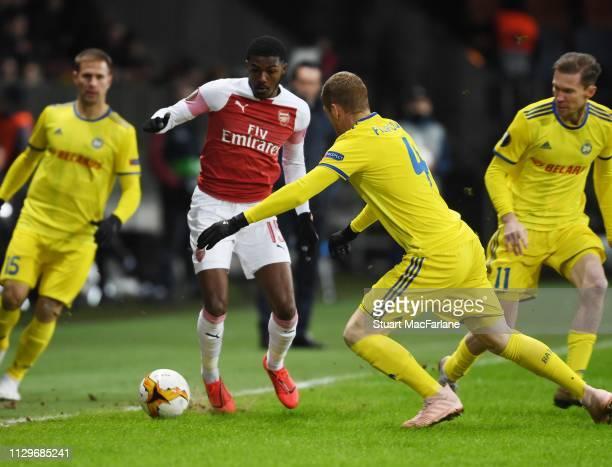 Ainsley MaitlandNiles of Arsenal takes on Aleksandar Filipovic of BATE during the UEFA Europa League Round of 32 First Leg match between BATE Borisov...
