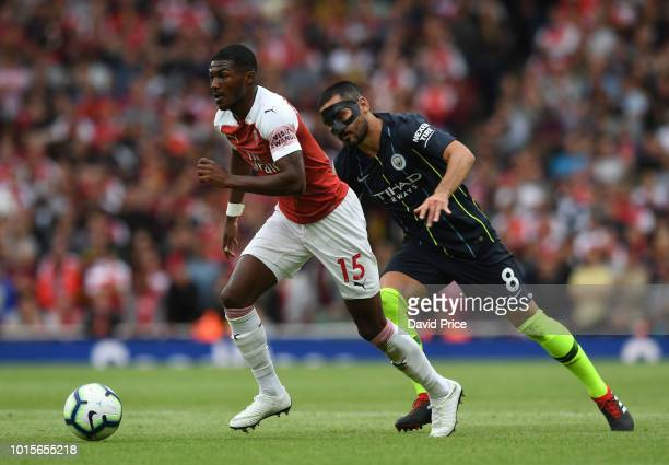 Ainsley MaitlandNiles of Arsenal takes on Ilkay Gundogan of Man City during the match the Premier League match between Arsenal FC and Manchester City...