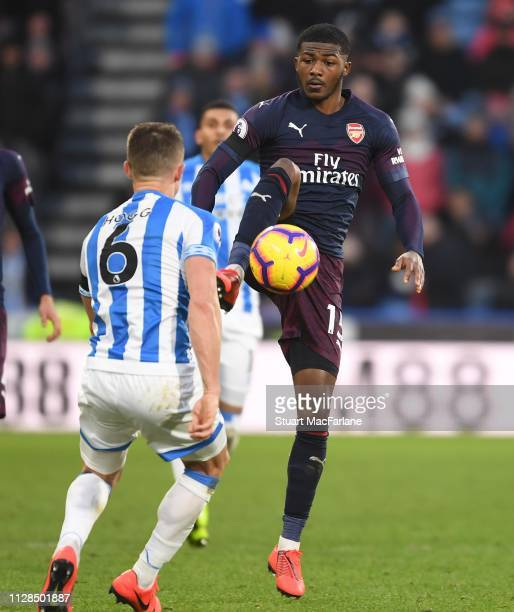 Ainsley MaitlandNiles of Arsenal takes on Jonathan Hogg of Huddersfield during the Premier League match between Huddersfield Town and Arsenal FC at...