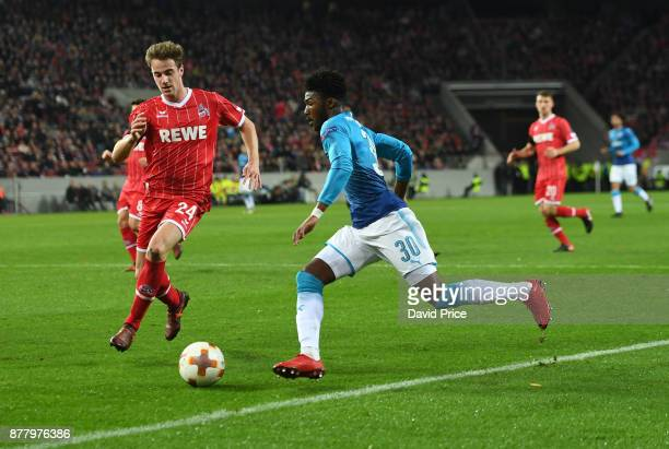 Ainsley MaitlandNiles of Arsenal takes on Lukas Klunter of Cologne during the UEFA Europa League group H match between 1 FC Koeln and Arsenal FC at...