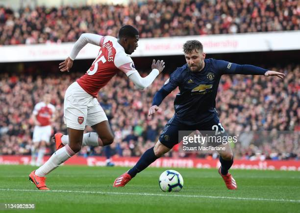 Ainsley MaitlandNiles of Arsenal takes on Luke Shaw of Man United during the Premier League match between Arsenal FC and Manchester United at...