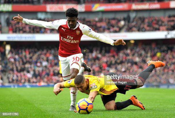 Ainsley MaitlandNiles of Arsenal tangles with Richarlison de Andrade of Watford during the Premier League match between Arsenal and Watford at...