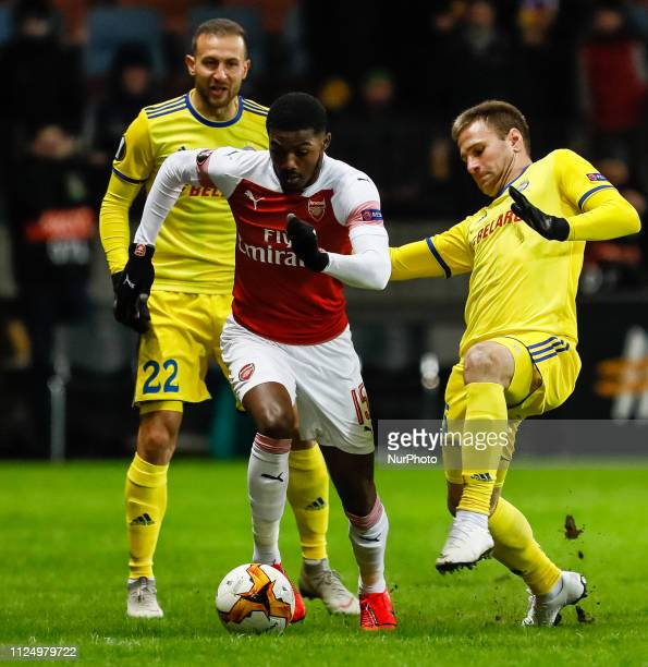 Ainsley MaitlandNiles of Arsenal vies for the ball with Igor Stasevich and Maksim Skavysh of BATE Borisov during the UEFA Europa League Round of 32...