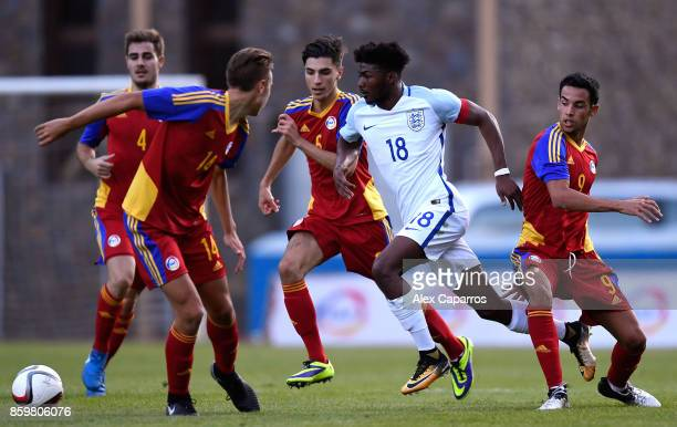 Ainsley MaitlandNiles of England goes past Aaron Sanchez of Andorra and Alex Villagrasa of Andorra during the UEFA European Under 21 Championship...