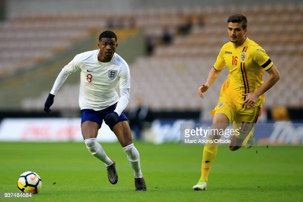 Ainsley MaitlandNiles of England in action with Dragos Nedlecu of Romania during the U21 International Friendly match between England U21 and Romania...