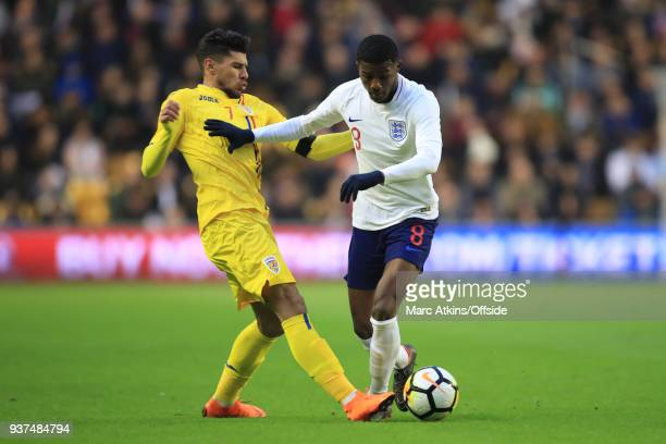 Ainsley MaitlandNiles of England in action with Florinel Coman of Romania during the U21 International Friendly match between England U21 and Romania...
