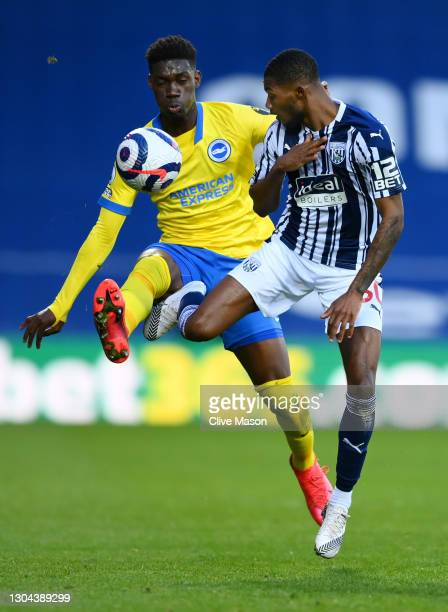 Ainsley Maitland-Niles of West Bromwich Albion is challenged by Yves Bissouma of Brighton and Hove Albion during the Premier League match between...