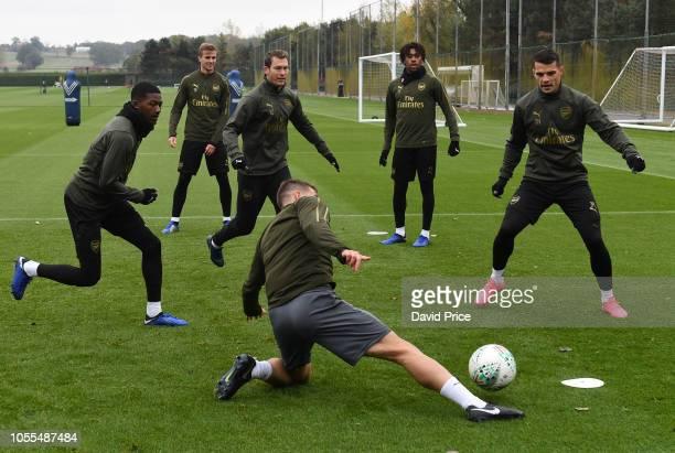 Ainsley MaitlandNiles Rob Holding Stephan Lichtsteiner Julio Pleguezuelo Alex Iwobi and Granit Xhaka of Arsenal during the Arsenal Training Session...