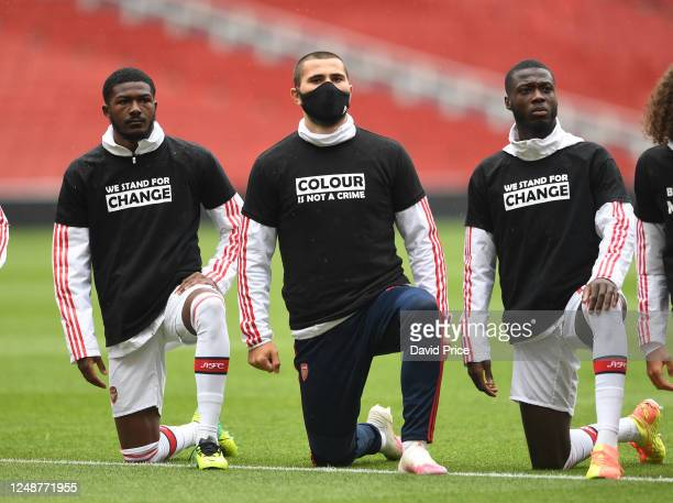 Ainsley MaitlandNiles Sead Kolasinac and Nicolas Pepe of Arsenal a knee in support of Black Lives Matter before the friendly match between Arsenal...