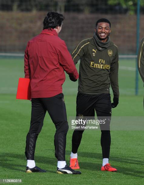 Ainsley MaitlandNiles shakes hands with Arsenal Head Coach Unai Emery before a training session at London Colney on February 13 2019 in St Albans...