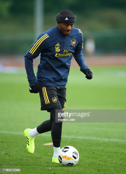 Ainsley Maitland-Niles takes part in a drill during an Arsenal training session on the eve of their UEFA Europa League match against Eintracht...