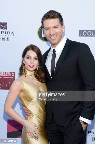 Ainsley Ross and Jesse Kove attend the 4th annual Roger Neal Oscar Viewing Dinner Icon Awards and after party at Hollywood Palladium on February 24...