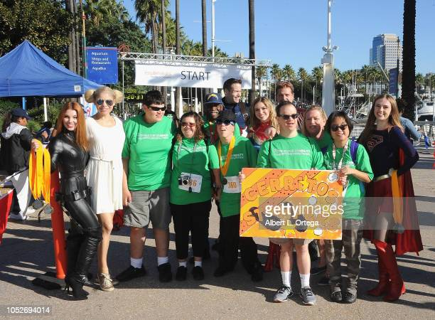 Ainsley Ross Anne McDaniels and Darth Lexii pose with attendees at Easter Seals Southern California's 'Strides For Disability 5K Run/Walk and 3K...