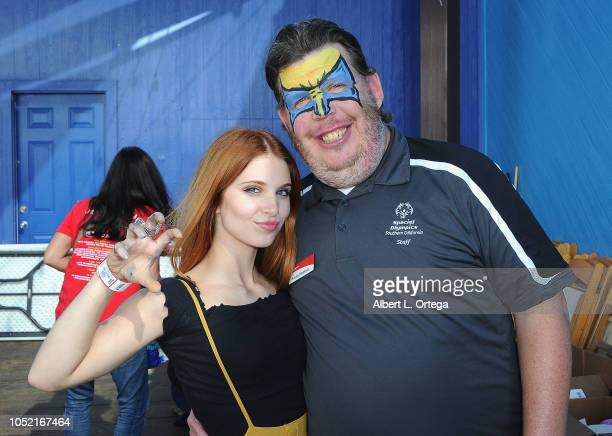 Ainsley Ross face paints Dustin Plunkitt of Special Olympics at the Special Olympics Pier Del Sol held at Pacific Park on the Santa Monica Pier on...