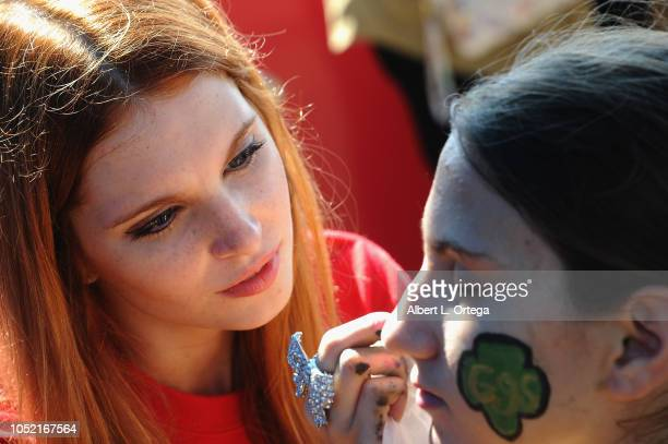 Ainsley Ross facepaints at the Special Olympics Pier Del Sol held at Pacific Park on the Santa Monica Pier on October 14 2018 in Santa Monica...