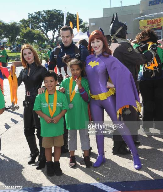 Ainsley Ross Jeff Knight and Tara Nicole Azarian pose with attendees at Easter Seals Southern California's 'Strides For Disability 5K Run/Walk and 3K...