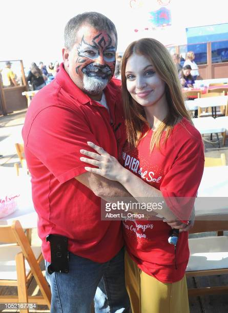 Ainsley Ross poses and face paints her father at the Special Olympics Pier Del Sol held at Pacific Park on the Santa Monica Pier on October 14 2018...