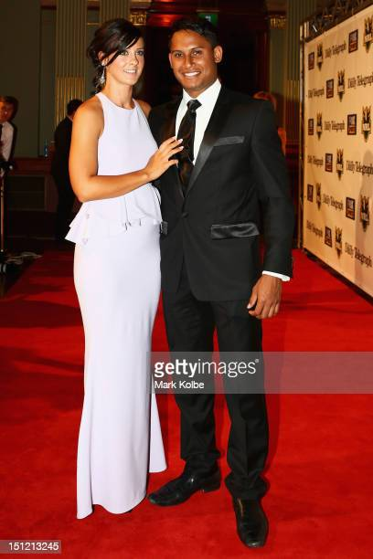Ainslie Curry and Ben Barba pose on the red carpet as they arrive for the 2012 NRL Dally M Awards at Sydney Town Hall on September 4, 2012 in Sydney,...