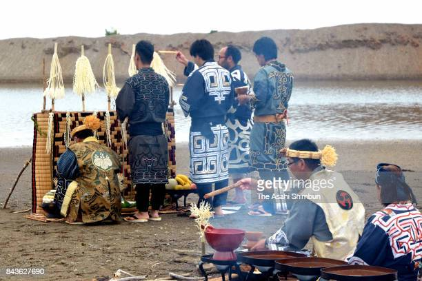 Ainu indigebous people hold the ritual called 'Pekkamuinomi' to welcome salmon running and good harvest at the bank of Uroyogawa River on September 6...