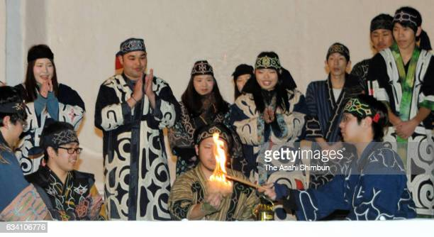 Ainu indigenous people ignite a flame for torch relay in their traditional method during the Winter Asian Games Sapporo Flame Lighting Ceremony on...