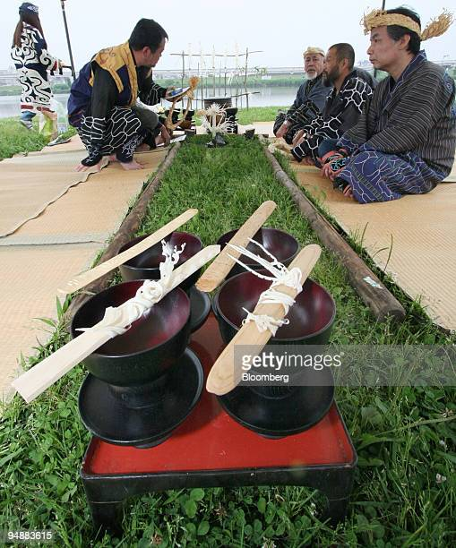 Ainu men and women carry out a ritual ancestor worshipping ceremony on a river bed in Tokyo Japan on Sunday April 8 2008 Japanese lawmakers passed a...