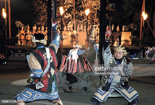 Ainu people dance during the Iomante fire festival at the Akanko Hot Spring on October 12 2005 in Kushiro Hokkaido Japan