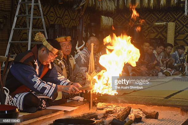 Ainu people pray for gods of fire and houses during the ceremony called 'Kotannomi' at Ainu Museum Porotokotan on November 1 2014 in Shiraoi Hokkaido...
