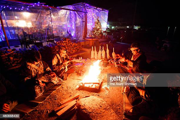 Ainu people pray for the victims of the tsunami of the Great East Japan Earthquake on December 20 2011 in Otsuchi Iwate Japan