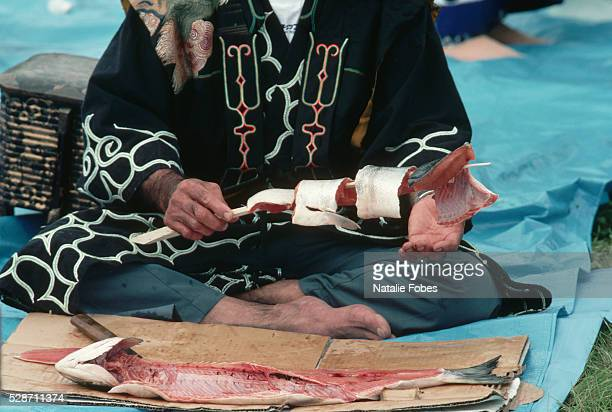 Ainu Prepares Salmon at First Salmon Ceremony