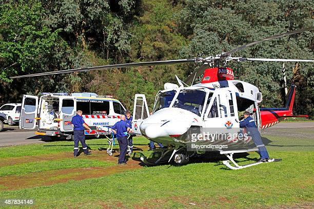 air ambulance helicopter evacuates rural accident victim to hospital - medevac stock photos and pictures