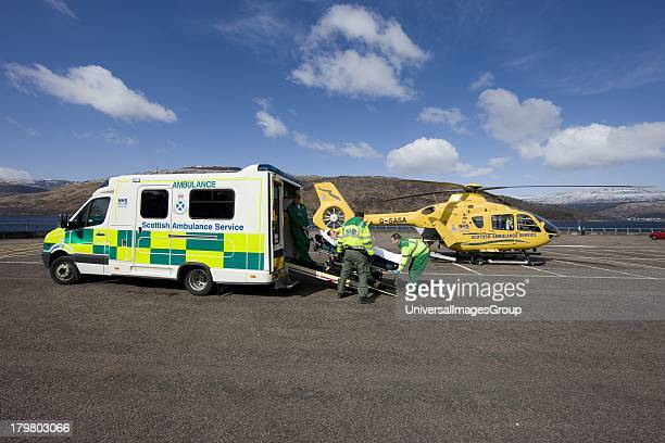 Air Ambulance helicopter prepares to receive a patient at Fort William Lochaber Scotland United Kingdom