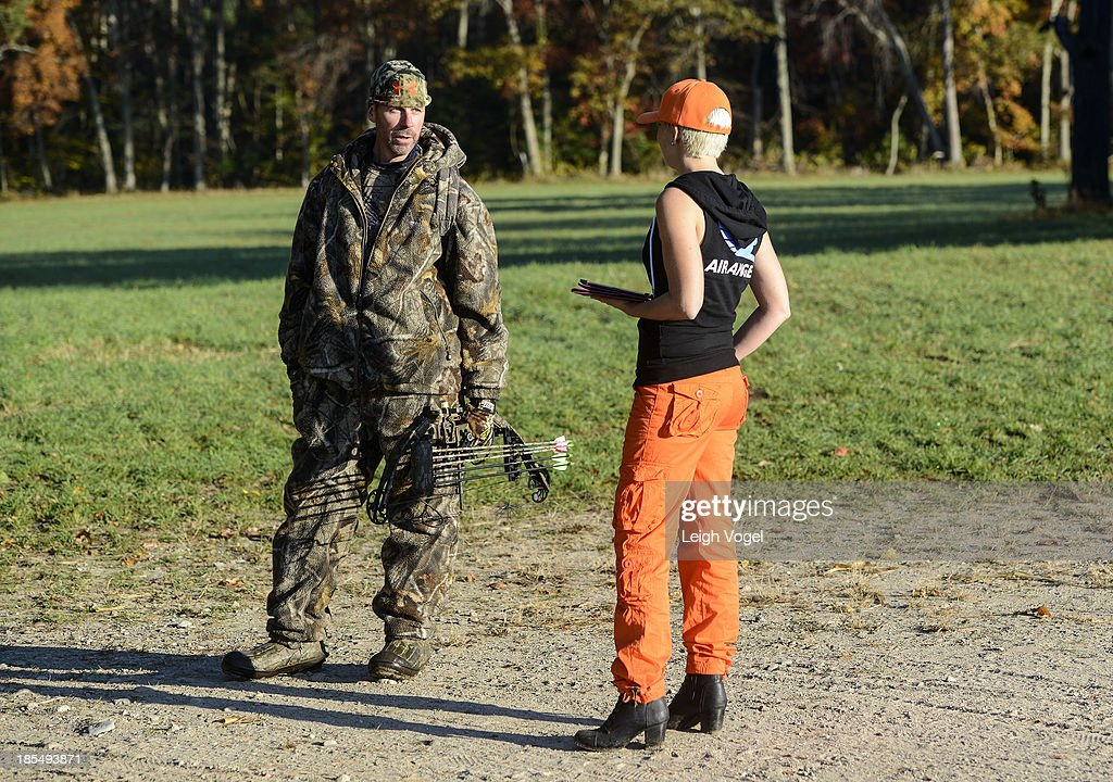 Air Angel Lindsay Rajt speaks with a hunter as drones capture footage in order to monitor illegal hunting practices at Erwin Wilder Wildlife Management Area at on October 21, 2013 in Norton, Massachusetts.