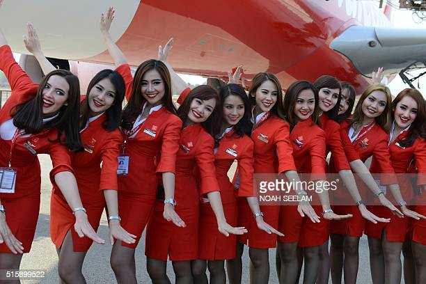 Air Asia cabin crew pose at The India Aviation 2016 airshow at Begumpet Airport in Hyderabad on March 16 2016 The fifth edition of India Aviation a...