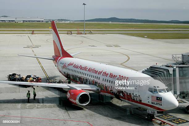 Air Asia the popular new discount Malaysian airline won the title 'Asia Pacific Airline of the Year' One of its planes is shown on the runway of...